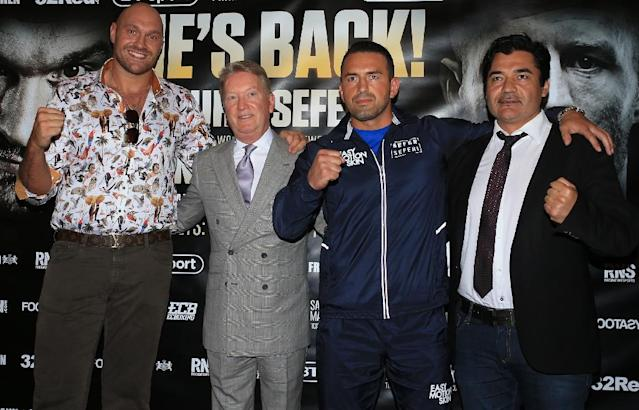 Tyson Fury (left) is making his boxing comeback against Sefer Seferi (second from right) after almost three years out (AFP Photo/Lindsey Parnaby)