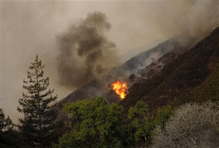 A blaze flares up during a wild fire in Big Sur