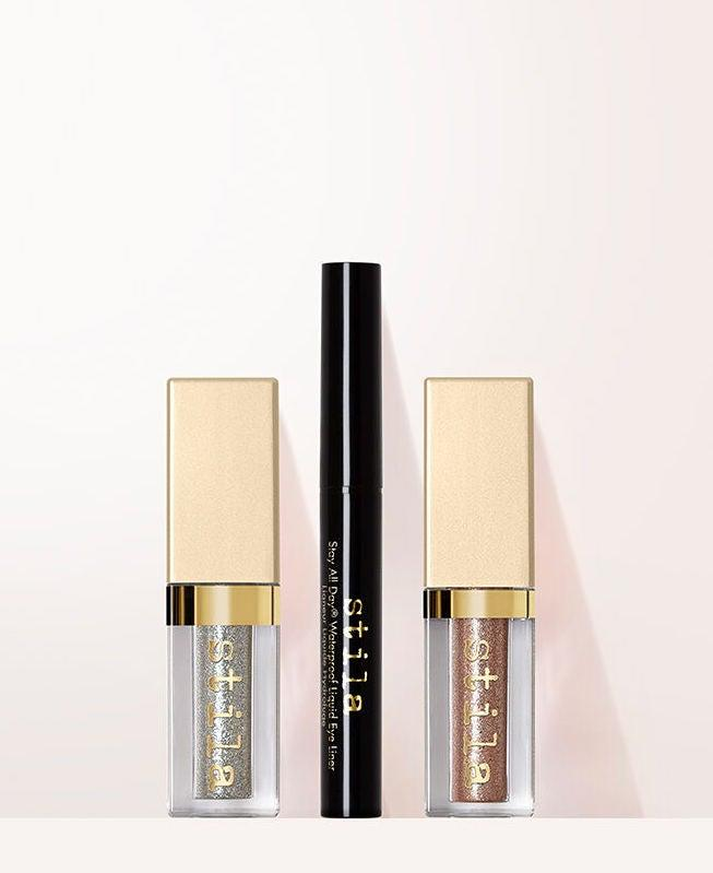 "<h3>Stila Eye Dare You Liquid Eye Liner & Eye Shadow Set<br></h3><br>They say good things come in threes, and this little bundle is no exception: A travel-size set of Stila's greatest hits, including the Stay All Day liquid eyeliner and two glittery liquid eyeshadows in champagne and silver. <br><br><strong>Stila</strong> Eye Dare You Liquid Eye Liner & Eye Shadow Set, $, available at <a href=""https://go.skimresources.com/?id=30283X879131&url=https%3A%2F%2Ffave.co%2F3jhAUJR"" rel=""nofollow noopener"" target=""_blank"" data-ylk=""slk:Stila"" class=""link rapid-noclick-resp"">Stila</a>"