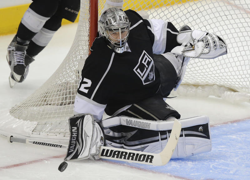 Los Angeles Kings goalie Jonathan Quick (32) blocks a shot by the Chicago Blackhawks during the second period of Game 3 of the NHL hockey Stanley Cup playoffs Western Conference finals, Tuesday, June 4, 2013, in Los Angeles. (AP Photo/Jae C. Hong)