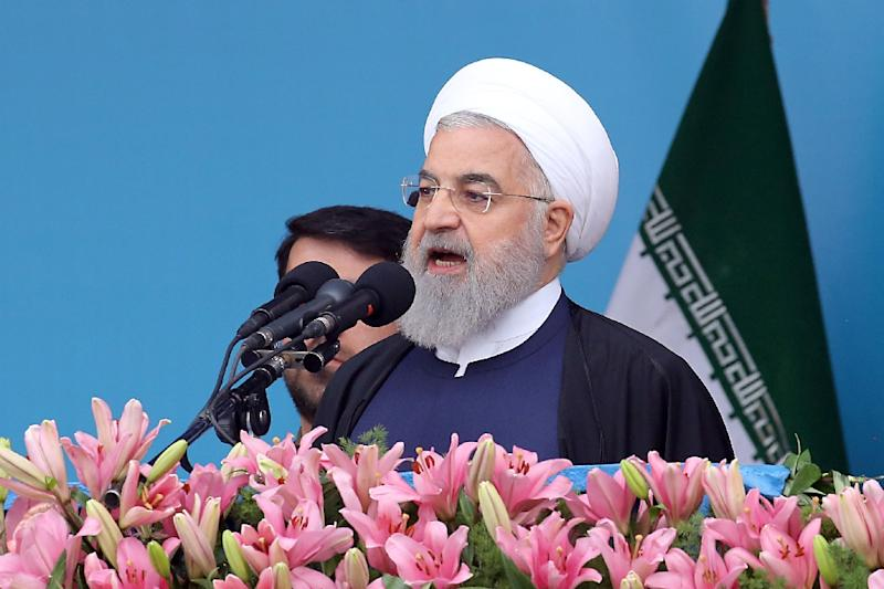 "President Hassan Rouhani has urged Iranians to ""resist and unite"" against US pressure (AFP Photo/-)"