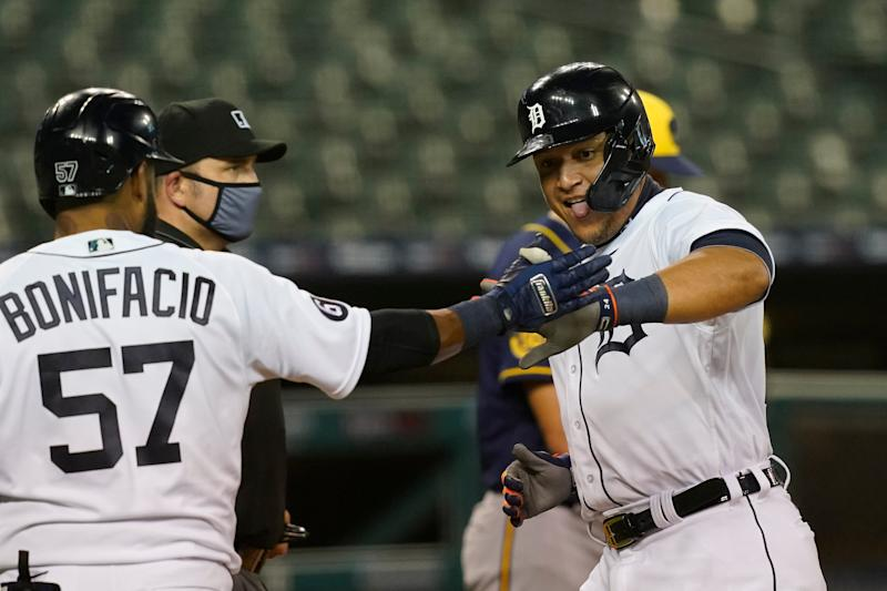 Tigers designated hitter Miguel Cabrera, right, is greeted at home by right fielder Jorge Bonifacio after scoring from second on a hit by Willi Castro during the fourth inning against the Brewers on Tuesday, Sept. 8, 2020, at Comerica Park.