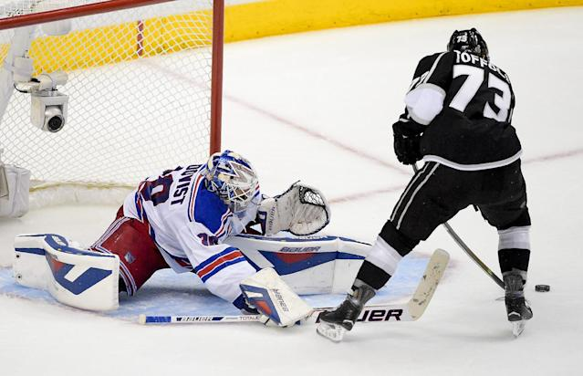 New York Rangers goalie Henrik Lundqvist, of Sweden, left, blocks a shot by Los Angeles Kings center Tyler Toffoli during the third period in Game 1 of the NHL hockey Stanley Cup Finals, Wednesday, June 4, 2014, in Los Angeles. (AP Photo/Mark J. Terrill)
