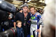 "<p>Pitt makes a rare appearance with son Knox at the British MotoGP Grand Prix. Pitt, a longtime fan of the sport, <a href=""https://www.latimes.com/business/autos/la-fi-hy-hitting-the-apex-movie-20151104-story.html"" rel=""nofollow noopener"" target=""_blank"" data-ylk=""slk:narrated and produced"" class=""link rapid-noclick-resp"">narrated and produced</a> <em>Hitting the Apex</em>, a motorcycle racing documentary.</p>"
