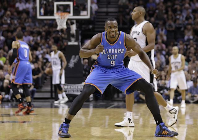 Oklahoma City Thunder's Serge Ibaka (9) celebrates a score against the San Antonio Spurs during the first half of Game 5 of the Western Conference finals NBA basketball playoff series, Thursday, May 29, 2014, in San Antonio. (AP Photo/Eric Gay)
