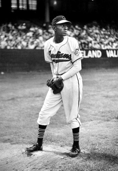 """<p><strong>July 9, 1948</strong>: Forty-two-year-old Satchel Paige makes his first appearance in the major leagues, a relief stint with the Cleveland Indians. """"While Jackie Robinson had broken the color line the year before, Paige represented something else: a Hall-of-Fame-quality pitcher denied his chance on baseball's biggest stage until the very end of his career,"""" says Wallace. At least Paige—who was inducted into the Hall in 1971—got to pitch in the majors; other great Negro League players, including Josh Gibson and Ray Oscar Charleston, never had the chance.<br> </p>"""
