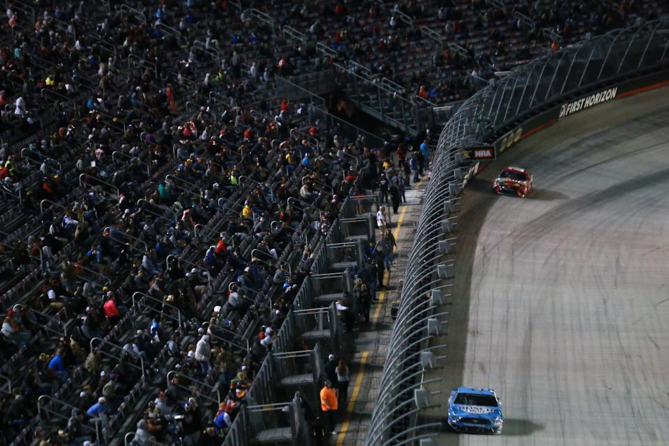 BRISTOL, TENNESSEE - SEPTEMBER 19: Fans watch race action during the NASCAR Cup Series Bass Pro Shops Night Race at Bristol Motor Speedway on September 19, 2020 in Bristol, Tennessee. (Photo by Sean Gardner/Getty Images)