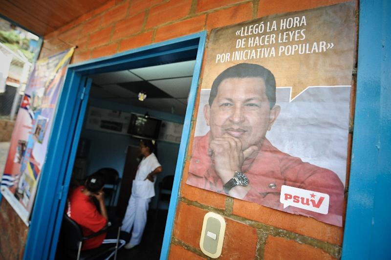 A poster with the face of the late Venezuelan president Hugo Chavez on the facade of a clinic in Caracas where a Cuban doctor works in 2010