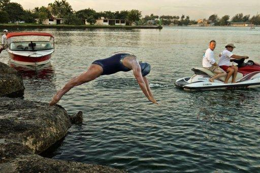 """British-Australian swimmer Penny Palfrey dives off the coast of western Havana to kick off her swim towards the US on June 29. Her team said Palfrey had to abort her bid to reach the Florida Keys at about midnight (0400 GMT Sunday) due to a strong southeast current """"that made it impossible for her to continue her swim."""""""