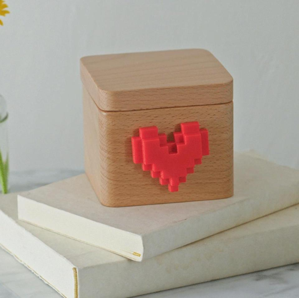 Send a message with this Lovebox Spinning Heart Messenger (Photo: Uncommon Good)