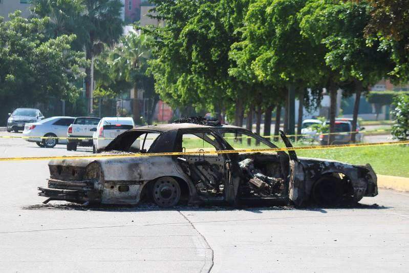 Burnt wreckage of police car is seen day after cartel gunmen clashed with federal forces in Culiacan