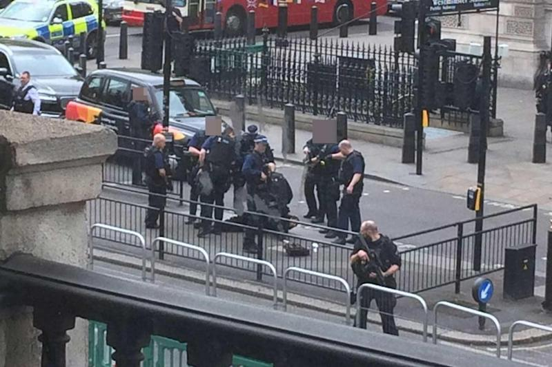 Tackled: Armed police surrounded the man in Westminster (Twitter/@3213dev)