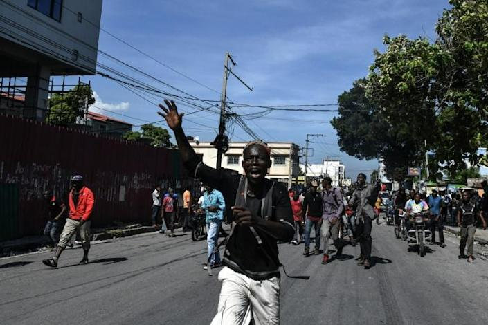 People demonstrate in the Haitian capital Port-au-Prince (AFP Photo/CHANDAN KHANNA)