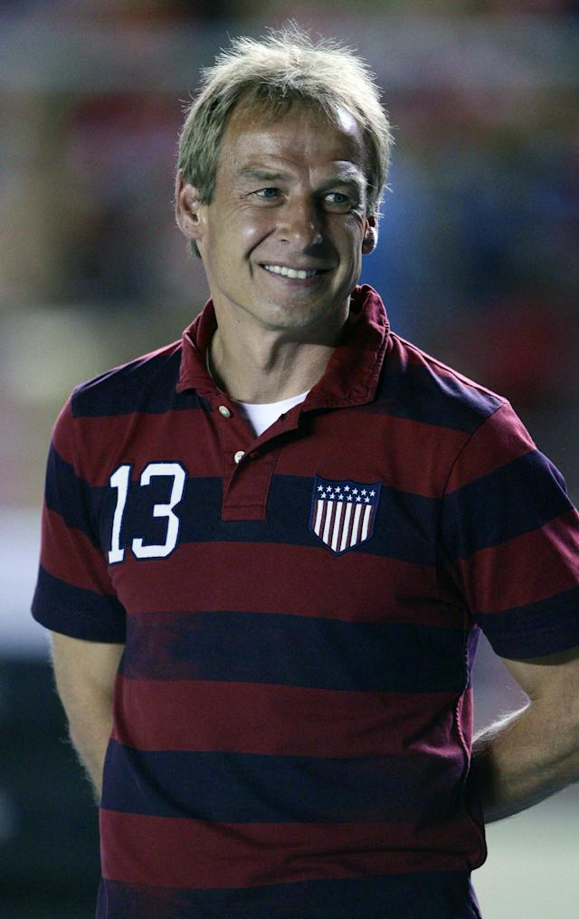 U.S. Jurgen Klinsmann, from Germany, stand on the pitch prior to a 2014 World Cup qualifying soccer match against Panama, in Panama City, Tuesday, Oct. 15, 2013. (AP Photo/Arnulfo Franco)