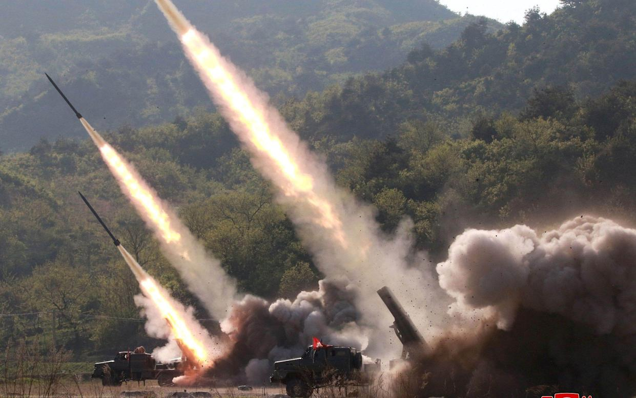 Missiles are seen launched during a military drill in North Korea in May 2019 - REUTERS