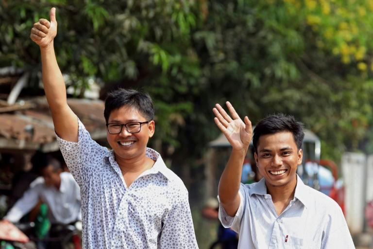 Wa Lone and Kyaw Soe Oo were mobbed by media as they stepped out of Yangon's notorious Insein prison after their lengthy detention
