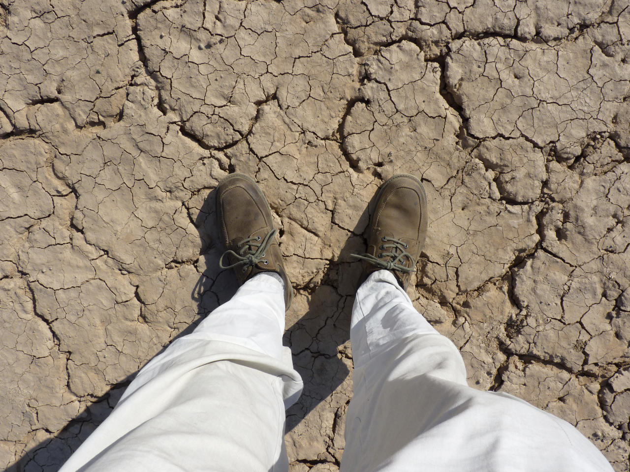 This photo taken Tuesday, Oct. 23, 2012 and released by the National Geographic Society on Thursday, Jan. 10, 2013, shows Paul Salopek standing on the desert flats in Djibouti. Two-time Pulitzer Prize-winning reporter Paul Salopek has taken the first steps of an unimaginably long walk - a 21,000-mile (34,000-kilometer) journey from Ethiopia to Argentina expected to last seven years. (AP Photo/National Geographic, Paul Salopek) NO SALES, ONE TIME USE ONLY NO ARCHIVE