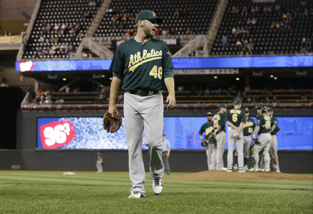 Oakland Athletics pitcher Ryan Cook has some words for plate umpire CB Bucknor as he leaves the baseball game after he walked Minnesota Twins' Chris Parmelee in the eighth inning of a baseball game, Tuesday, Sept. 10, 2013 in Minneapolis. The Twins won 4-3, with Cook taking the loss. (AP Photo/Jim Mone)