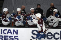 Colorado Avalanche right wing Mikko Rantanen (96) celebrates his goal with teammates on the bench during the first period of an NHL hockey game against the Los Angeles Kings Friday, May 7, 2021, in Los Angeles. (AP Photo/Marcio Jose Sanchez)