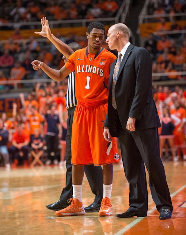 Illinois' Jaylon Tate (1) talks with Illinois head coach John Groce, right, during the second half of an NCAA college basketball game against Chicago State, Friday, Nov. 22, 2013, in Champaign, Ill. Illinois defeated Chicago State 77-53. (AP Photo/Darrell Hoemann)