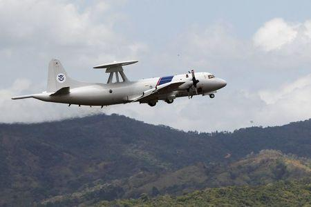 A US Lockheed P-3 Orion variant is seen after it took off from Tocumen international airport during an organized media visit in Panama City