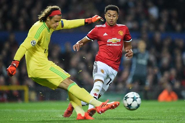 Benfica's goalkeeper Mile Svilar (L) clears the ball under pressure from Manchester United's Jesse Lingard during their UEFA Champions League Group A second leg match, at Old Trafford in Manchester, on October 31, 2017 (AFP Photo/Oli SCARFF )