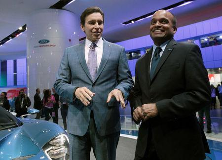 Ford CEO Mark Fields (L) and Raj Nair, Group VP Global Product Development, speak next to a Ford GT during the second press day of the North American International Auto Show in Detroit, Michigan January 13, 2015. REUTERS/Rebecca Cook/File Photo