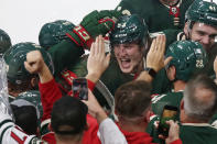 Minnesota Wild center Adam Beckman (53) is celebrates with teammates and fans after scoring in overtime against the St. Louis Blues during an NHL preseason hockey game Wednesday, Oct. 6, 2021, in St. Paul, Minn. (AP Photo/Andy Clayton-King)