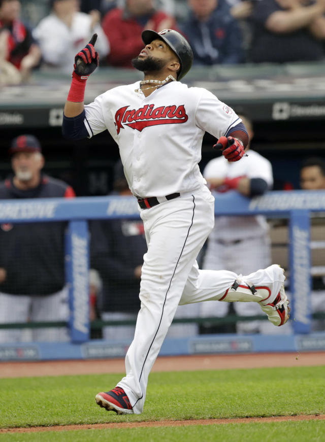 Cleveland Indians' Carlos Santana looks up as he runs the bases after hitting a solo home run off Oakland Athletics starting pitcher Chris Bassitt in the third inning of a baseball game, Tuesday, May 21, 2019, in Cleveland. (AP Photo/Tony Dejak)