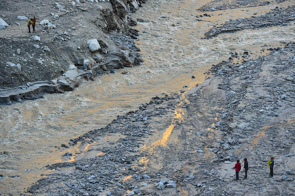 Local villagers on contract carry out rescue and restoration work near Reni village on Thursday, 11 February 2021, after Sunday's glacier burst in Joshimath caused a massive flood in the Dhauli Ganga river, in Chamoli district of Uttarakhand.