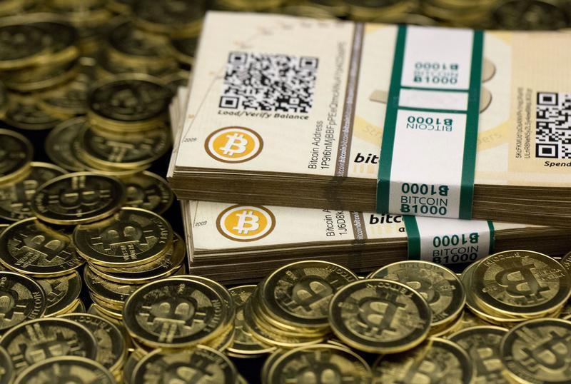 """Some of Bitcoin enthusiast Mike Caldwell's coins and paper vouchers often called """"paper wallets"""" are pictured at his office in Sandy, Utah"""