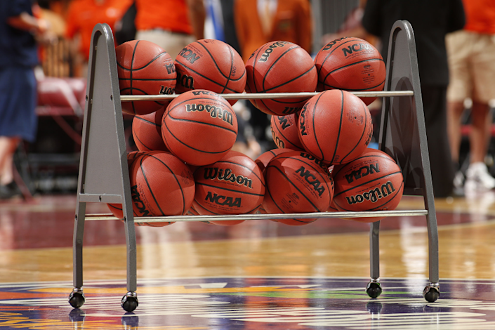SUNRISE, FL - DECEMBER 21: NCAA basketballs in a rack on the court.