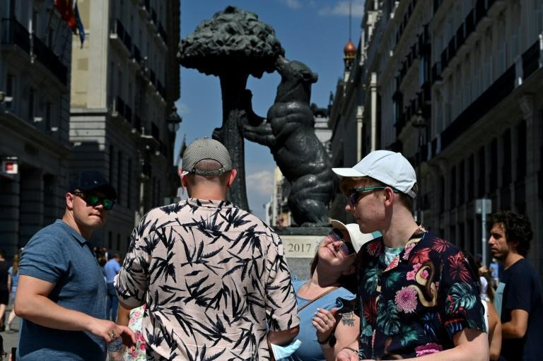 Tourists in Madrid profit from the recent relaxation of the requirement to wear masks on the street