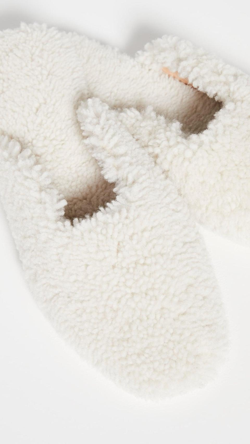 <p>Because their feet deserve to be stylish too, get them the <span>Sleeper Shearling Slippers</span> ($290).</p>
