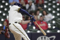 Milwaukee Brewers' Travis Shaw hits an RBI double during the sixth inning of the team's baseball game against the St. Louis Cardinals on Tuesday, May 11, 2021, in Milwaukee. (AP Photo/Aaron Gash)