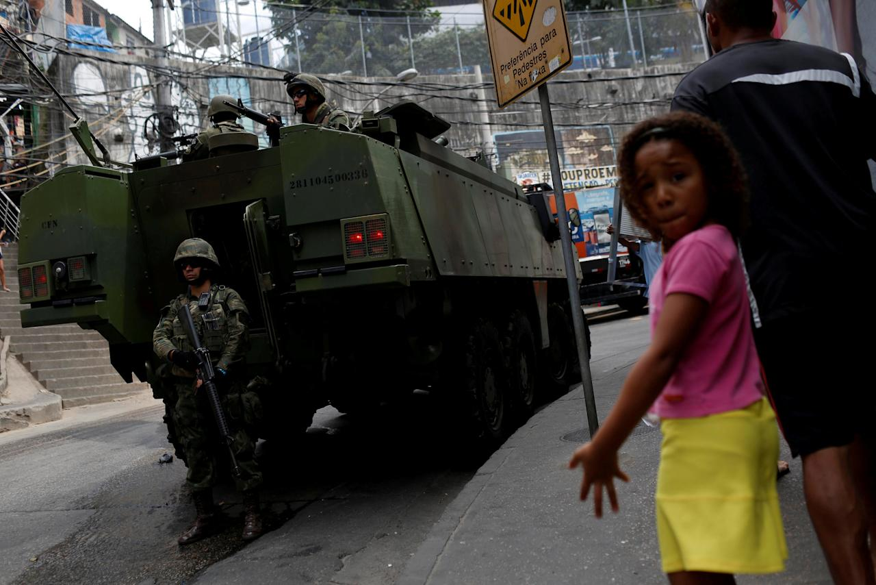 A military vehicle is pictured during an operation after violent clashes between drug gangs in Rocinha slum in Rio de Janeiro, Brazil, September 23, 2017. REUTERS/Bruno Kelly     TPX IMAGES OF THE DAY