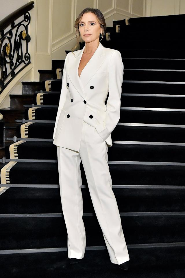 wears a white triple-breasted suit at the Violet Grey x Victoria Beckham Beauty dinner in Beverly Hills.
