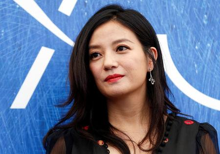 Actress Zhao Wei, member of Venezia 73 International Jury, poses for photographers during a photocall at the 73rd Venice Film Festival in Venice