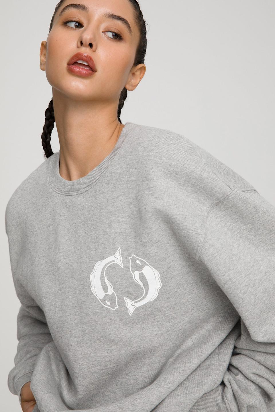 The Pisces Zodiac Sweat Set from Good American. Sweatshirt, $124 and sweatpants $105.