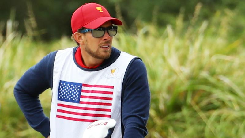 Presidents Cup 2019: Patrick Reed's caddie banned after clash with fan