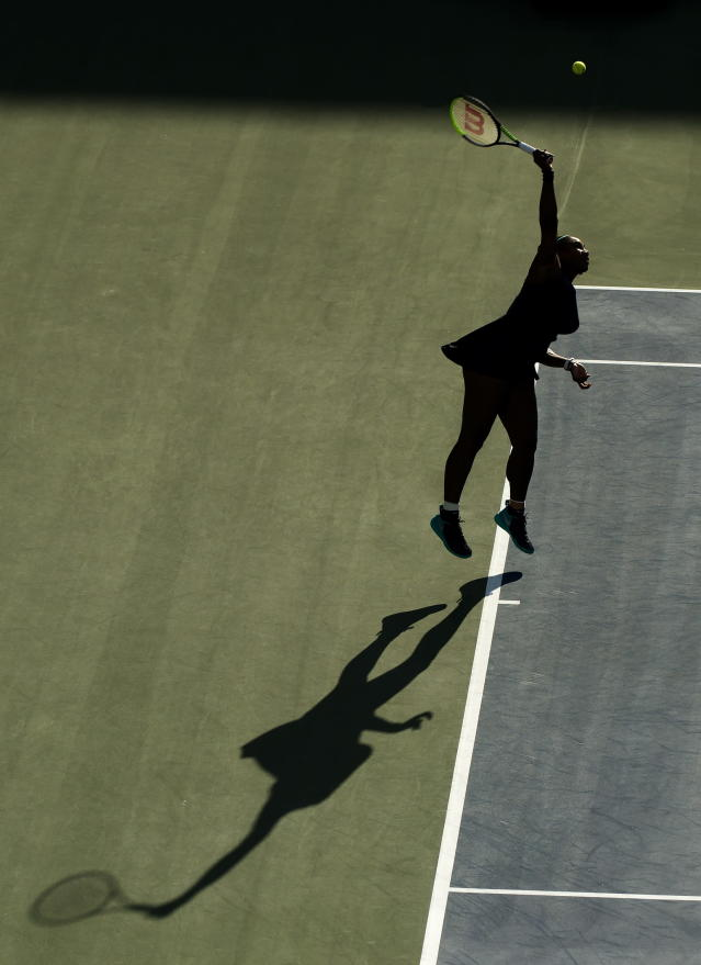 Serena Williams, of the United States, serves the ball against Marie Bouzkova, of the Czech Republic, during semifinal Rogers Cup tennis tournament action in Toronto, Saturday, Aug. 10, 2019. (Nathan Denette/The Canadian Press via AP)