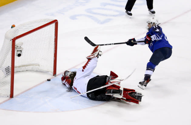 Jocelyne Lamoureux-Davidson scores against Shannon Szabados in the shootout during the gold medal game at PyeongChang.