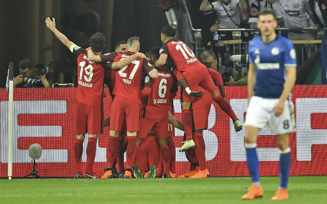 Frankfurt's Luka Jovic is celebrated by his team after scoring the opening goal during the German soccer cup semifinal match between FC Schalke 04 and Eintracht Frankfurt in Gelsenkirchen, Germany, Wednesday, April 18, 2018. (AP Photo/Martin Meissner)