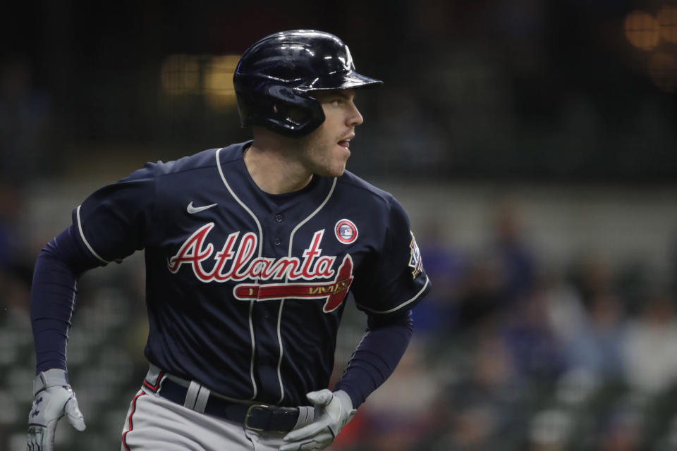 Atlanta Braves' Freddie Freeman watches his two-run home run during the second inning of the team's baseball game against the Milwaukee Brewers on Saturday, May 15, 2021, in Milwaukee. (AP Photo/Aaron Gash)