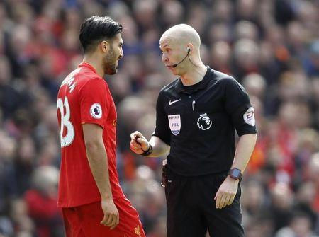 Britain Soccer Football - Liverpool v Everton - Premier League - Anfield - 1/4/17 Liverpool's Emre Can speaks to referee Anthony Taylor Action Images via Reuters / Carl Recine Livepic