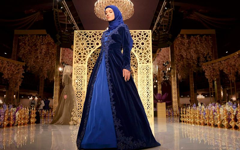Models present creations by fashion designer Aishat Kadyrov, daughter of Chechen regional leader Ramzan Kadyrov - Reuters