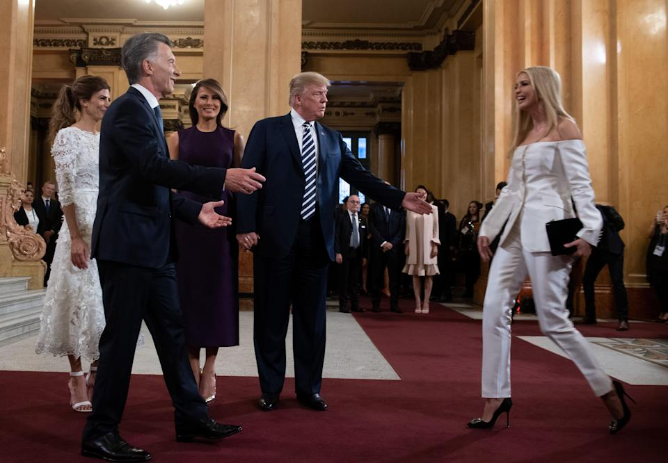 At an Argentinian gala, Ivanka Trump (pictured with Jared Kushner, President and Melania Trump, and Argentina's President Mauricio Macri and First Lady Juliana Awada) wore a pantsuit by designer Gabriela Hearst, who has criticized the Trump administration. (Photo: Getty Images)