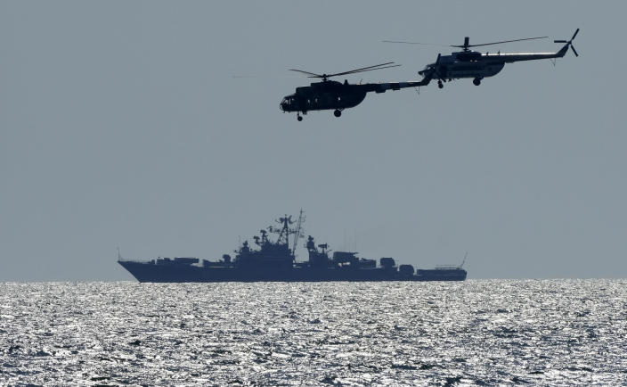 Ukrainian helicopters fly over a Russian warship during Sea Breeze 2021 maneuvers, in the Black Sea, Friday, July 9, 2021. Ukraine and NATO have conducted Black Sea drills involving dozens of warships in a two-week show of their strong defense ties and capability following a confrontation between Russia's military forces and a British destroyer off Crimea last month. (AP Photo/Efrem Lukatsky)