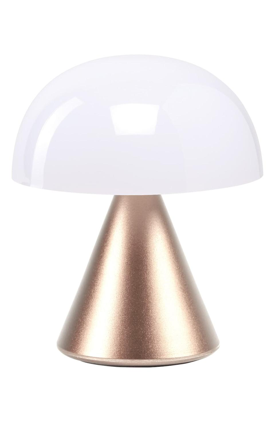 """This portable LED lamp featureswarm and cool settings, a dimmer setting and a six-hour battery life. It comes with a USB-charging cable and LED bulb.Plus, it has an Art Deco vibe that's <a href=""""https://www.washingtonpost.com/lifestyle/magazine/a-century-after-art-decos-birth-designers-say-were-due-for-a-revival/2020/04/01/8b0e1826-5d7f-11ea-b014-4fafa866bb81_story.html"""" target=""""_blank"""" rel=""""noopener noreferrer"""">pretty popular</a> right now.<a href=""""https://fave.co/32zqgJf"""" target=""""_blank"""" rel=""""noopener noreferrer"""">Find it for $30 at Nordstrom</a>."""