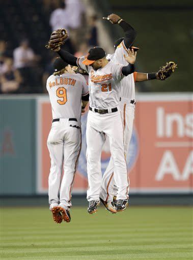 Baltimore Orioles' Nate McLouth(9), Nick Markakis (21) and Adam Jones celebrate their 5-1 win against the Los Angeles Angels after a baseball game in Anaheim, Calif., Thursday, May 2, 2013. (AP Photo/Jae C. Hong)